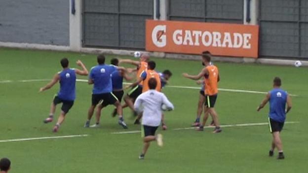 Juan Manuel Insaurralde and Jonathan Silva of Boca Juniors fight at training