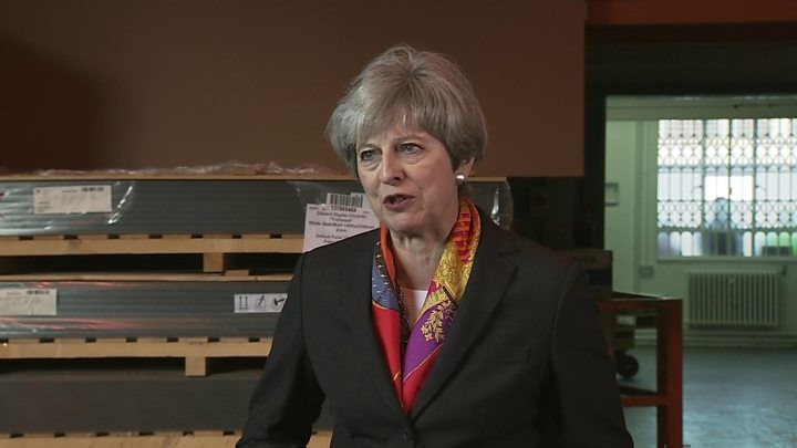 May apologises to own MPs for election 'mess'