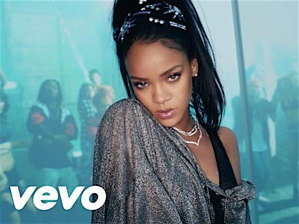 Rihanna pictured on set of her music video in revealing top