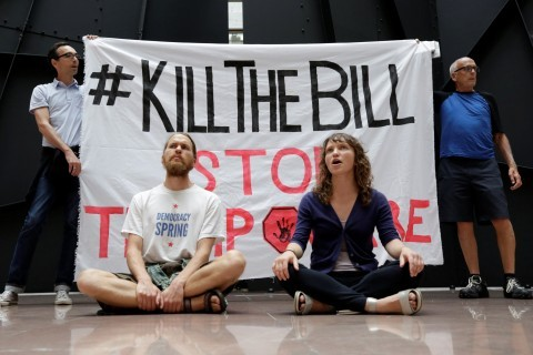 Activists, wary of health-care bill pause, plan more protests against proposal