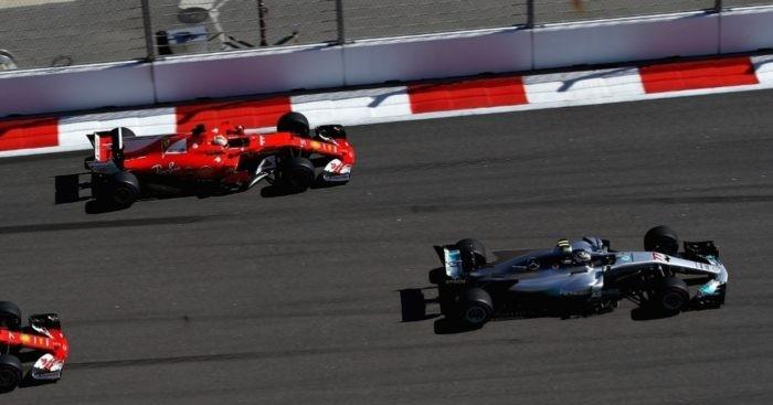 Bottas holds off Vettel to win