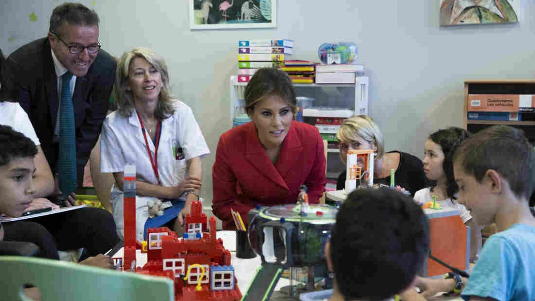 First Lady's Day in Paris Includes Children's Hospital, Church And An Awkward Moment