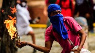 Venezuela crisis: Deadly clashes as millions join strike