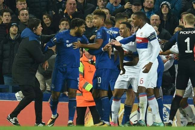 Everton Club ban fan who attacked Lyon player while holding child Everton on Friday banned a fan who appeared to try and strike a Lyon player while holding a child during their Europa League tie as UEFA opened disciplinary proceedings following the crowd trouble at Goodison Park.