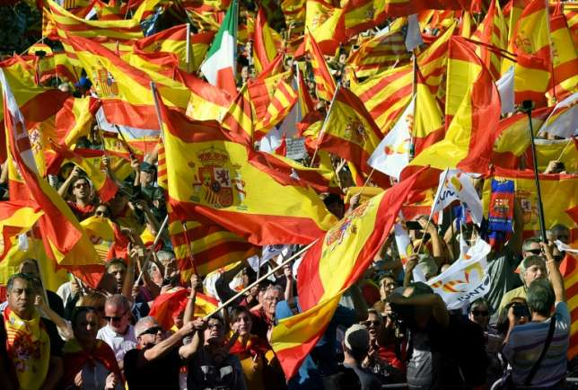 'Catalonia Is Spain!' Crowd chants at Barcelona rally That was a reference to the decision by Catalonia's two biggest banks to move their legal headquarters to other parts of Spain in recent weeks due to the political tension.