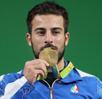 Olympic weightlifter sells his gold medal to raise money for Iran earthquake victims