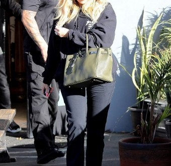 Pregnant Khloe Kardashian seen trying to hide her baby bump with a Hermes bag