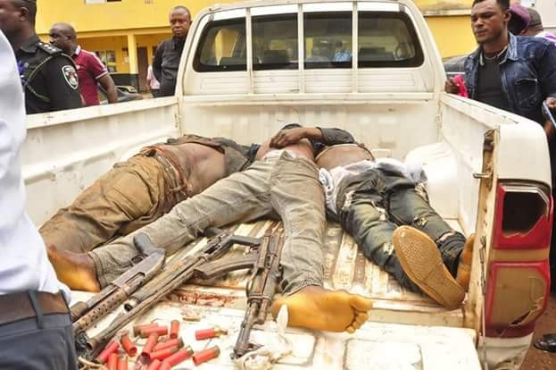 Police parade corpses of three armed robbers killed during foiled bank robbery attack in Edo state, Nigeria
