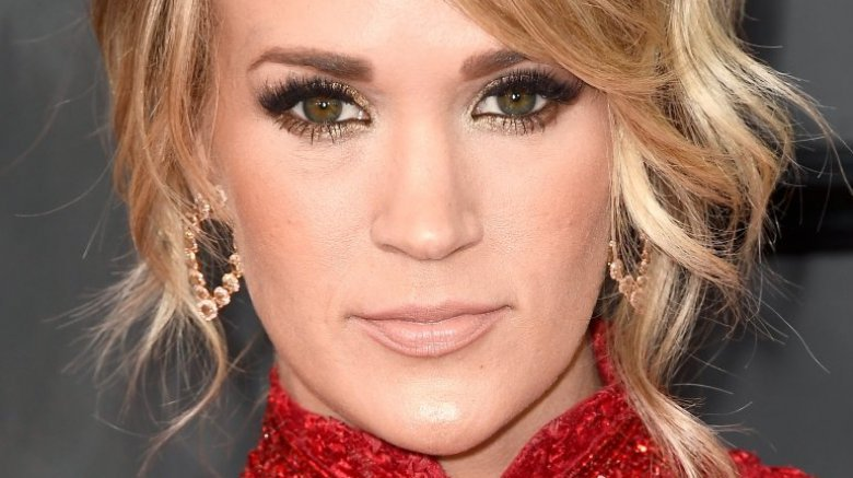 Pregnant Carrie Underwood reveals she suffered three miscarriages
