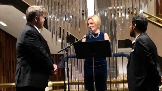 Alberta premier officiates cabinet minister's historic same-sex wedding