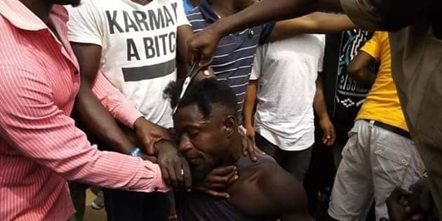 Photos: Outrage as youths storm market in Gboko, Benue and forcefully shaved young men with 'long' and afro hair