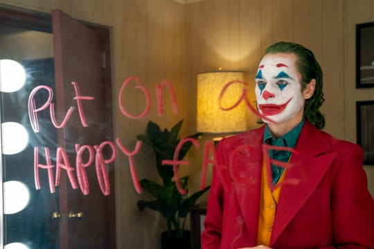 Arthur Fleck (Joaquin Phoenix) goes down a dark, face-painted path in Todd Phillips' psychological drama