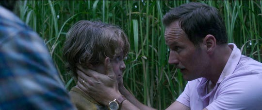 Tobin (Will Buie Jr., left) and his dad (Patrick Wilson) try to figure out a way out of a supernatural maze of plant life in