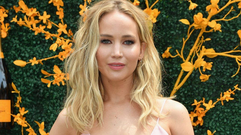 Why did Jennifer Lawrence's wedding dress get its own hotel room?