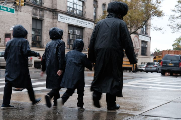 Members of the Jewish community walk through a Brooklyn neighborhood on Oct. 9, 2019, in New York City.