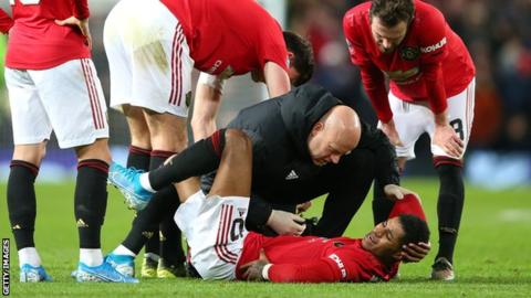 Football News : Marcus Rashford Manchester United striker a doubt for Liverpool match after back injury
