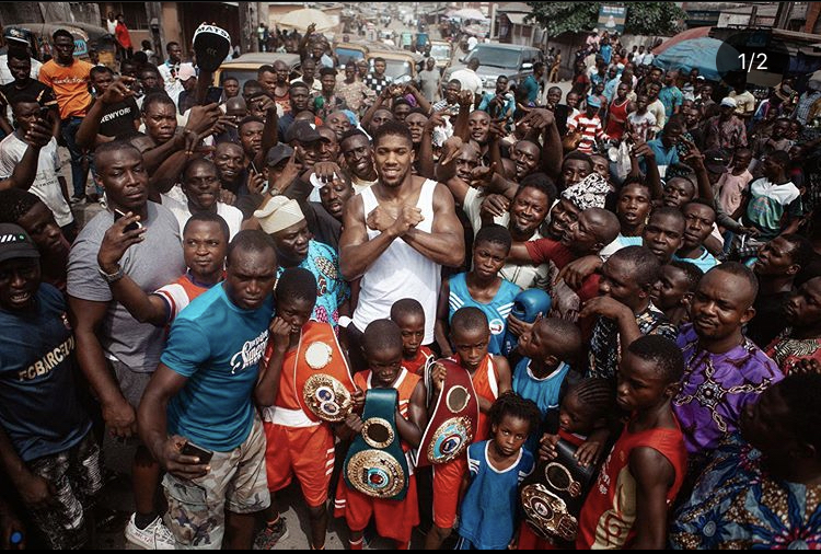 Joshua Visits Makoko Community, Hands Over His Heavyweight Belts To Kids In Order To Inspire Them (Photos)