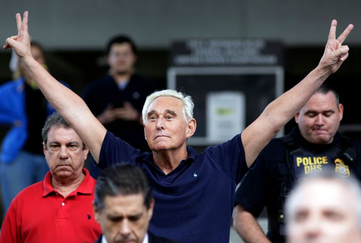 Stone exits a federal courthouse after his indictment on obstruction and lying to Congress. He flashes the double V sign