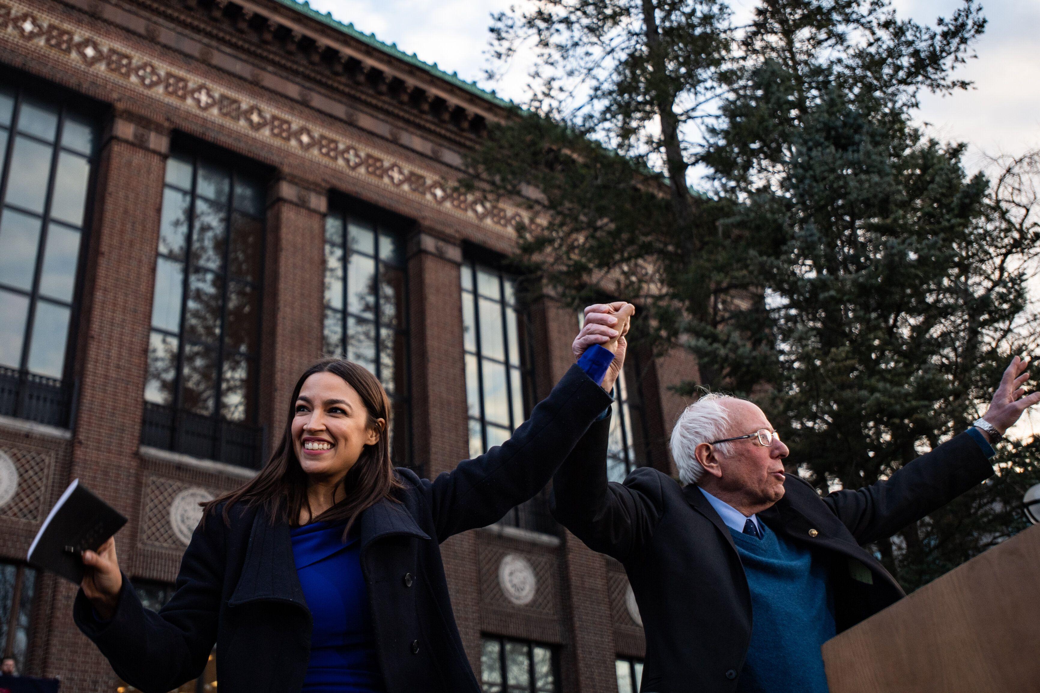 Rep. Alexandria Ocasio-Cortez (D-N.Y.) introduces Sen. Bernie Sanders (I-Vt.) in Ann Arbor, Michigan, on Sunday. It was her f