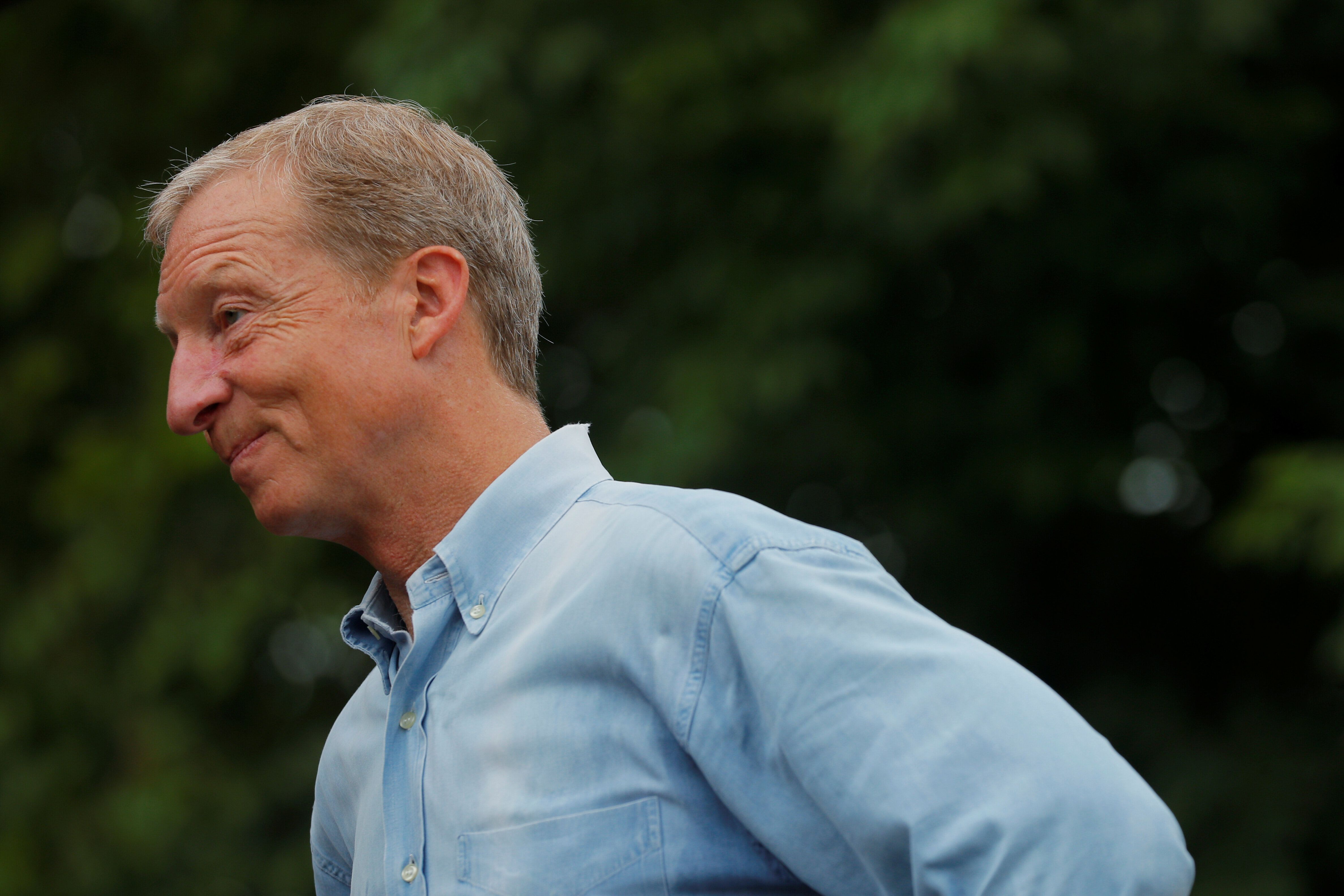 Tom Steyer waits to speak at the Iowa State Fair in Des Moines in August. He has since dropped out of the presidential race.