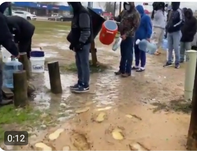 Residents of Houston Texas line up to fill containers from a public tap as power outage extends for days, making it impossible to supply water to homes