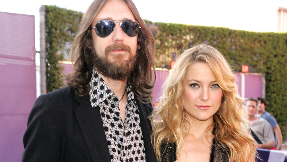 Chris Robinson and Kate Hudson posing at an event