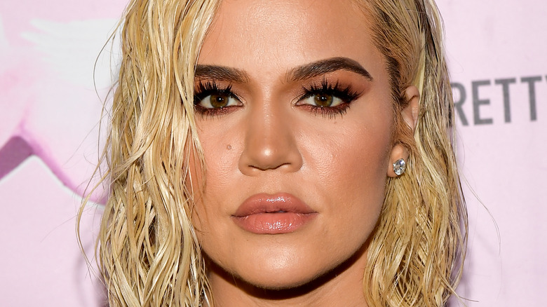 Khloe Kardashian with a serious expression