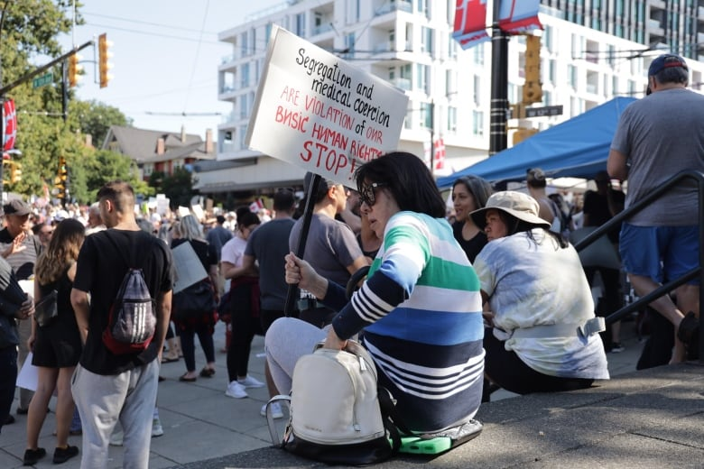 B.C. officials decry targeting of health-care workers as thousands protest vaccine passports